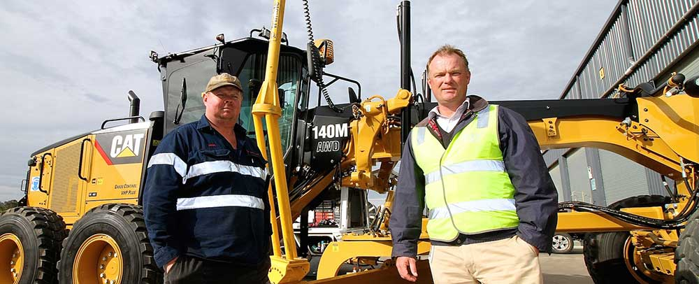 Mick Simmich has just taken ownership of his latest Cat 140M motor grader